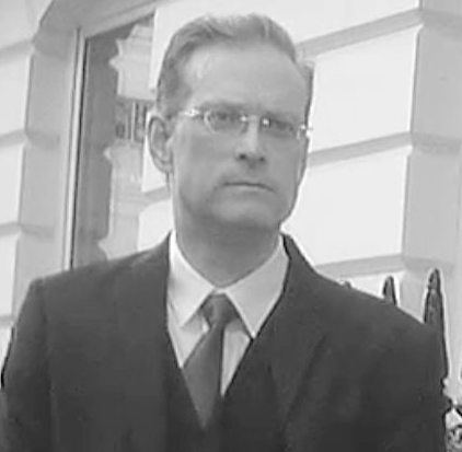 a black and white photo of Greg Johnson