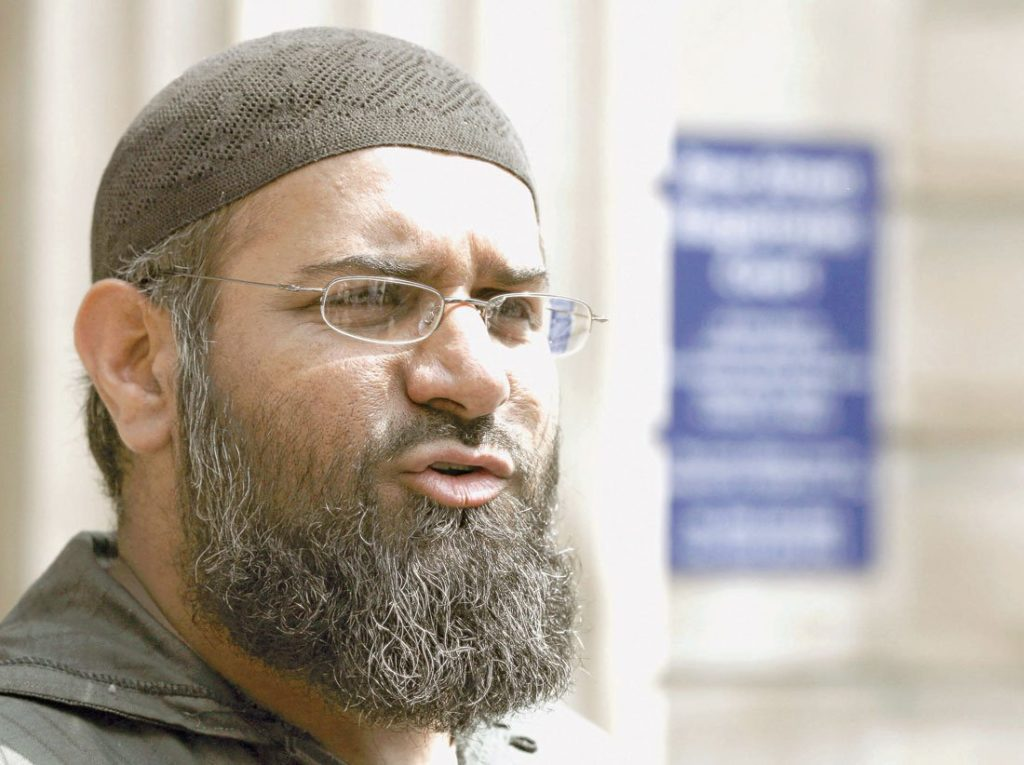 Anjem Choudary is outside a building talking