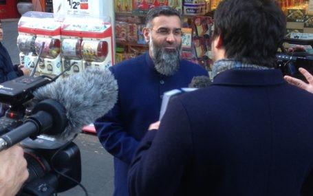 a journalist interviewing Anjem Choudary