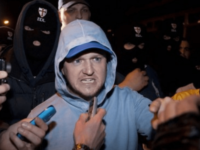 a picture of far right thug Stephen Yaxley-Lennon AKA Tommy Robinson looking angry