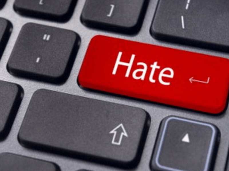"a keyboard with the word ""hate"" written on it"