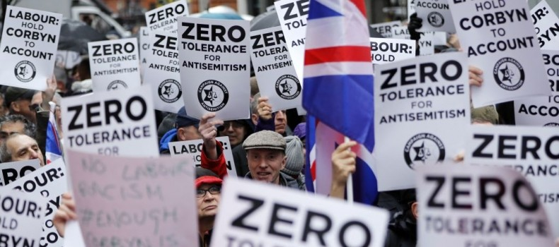 People holding placards, protesting against antisemitism in the Labour Party