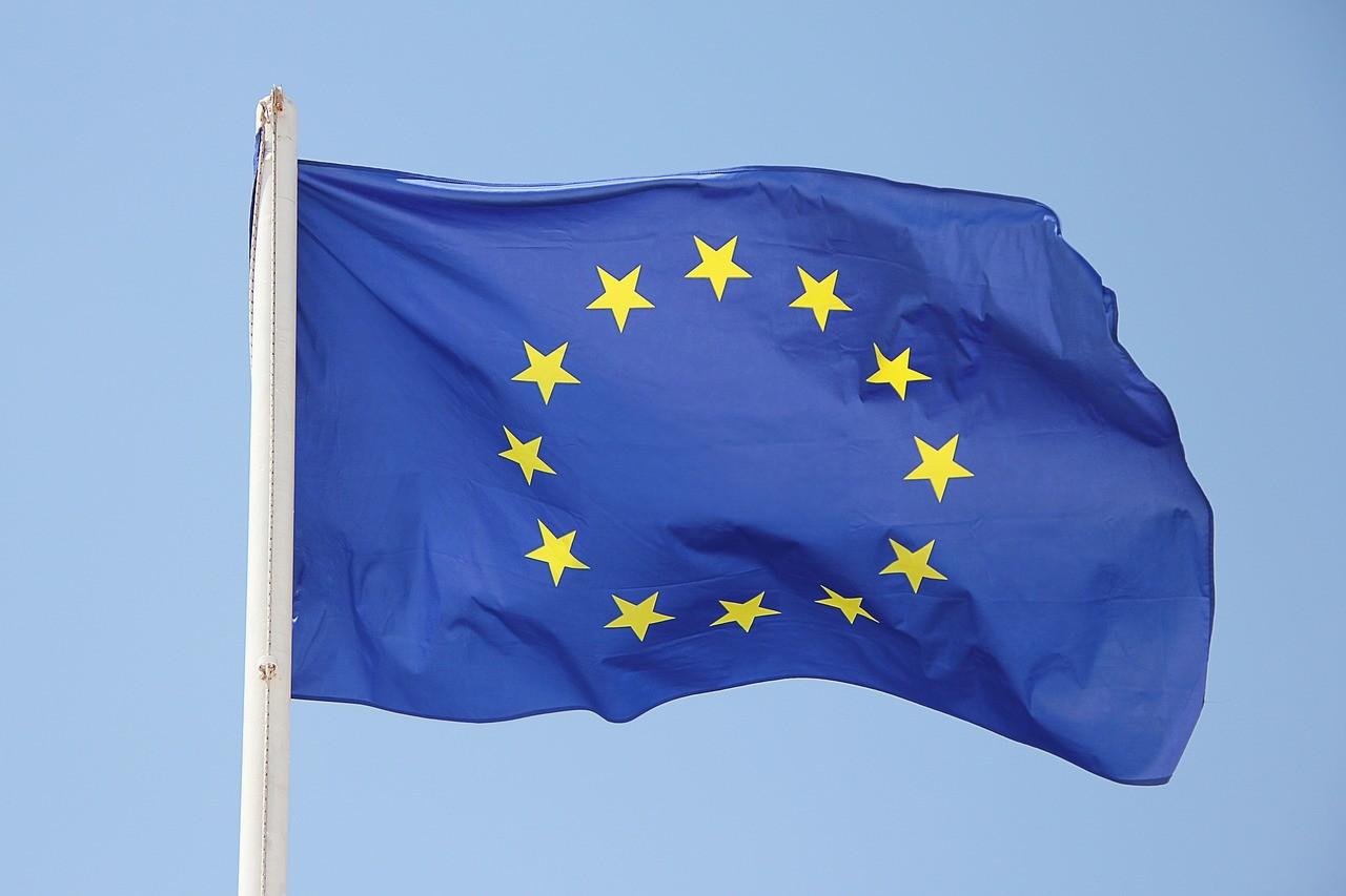 the EU flag waving in the sky