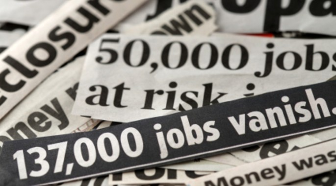 newspaper headlines referring to job losses and mass unemployment