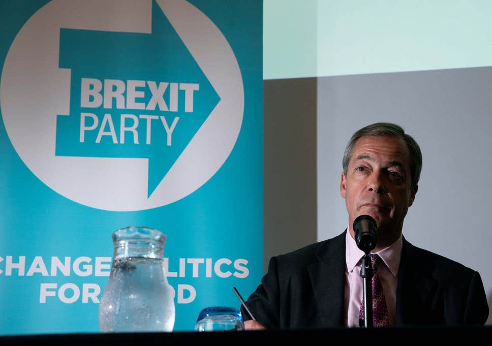 a picture of Nigel Farage giving a speech with Brexit Party logo in the background