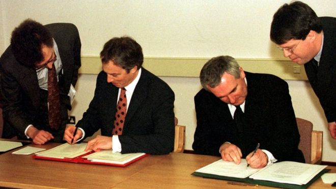 The prime minister at the time, Tony Blair, and then Taoiseach (Irish Prime Minister) Bertie Ahern sign the Good Friday Agreement