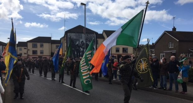 Men and women in paramilitary uniforms parade through the Bogside area of Derry on Monday as part of a dissident republican Easter Commemoration.