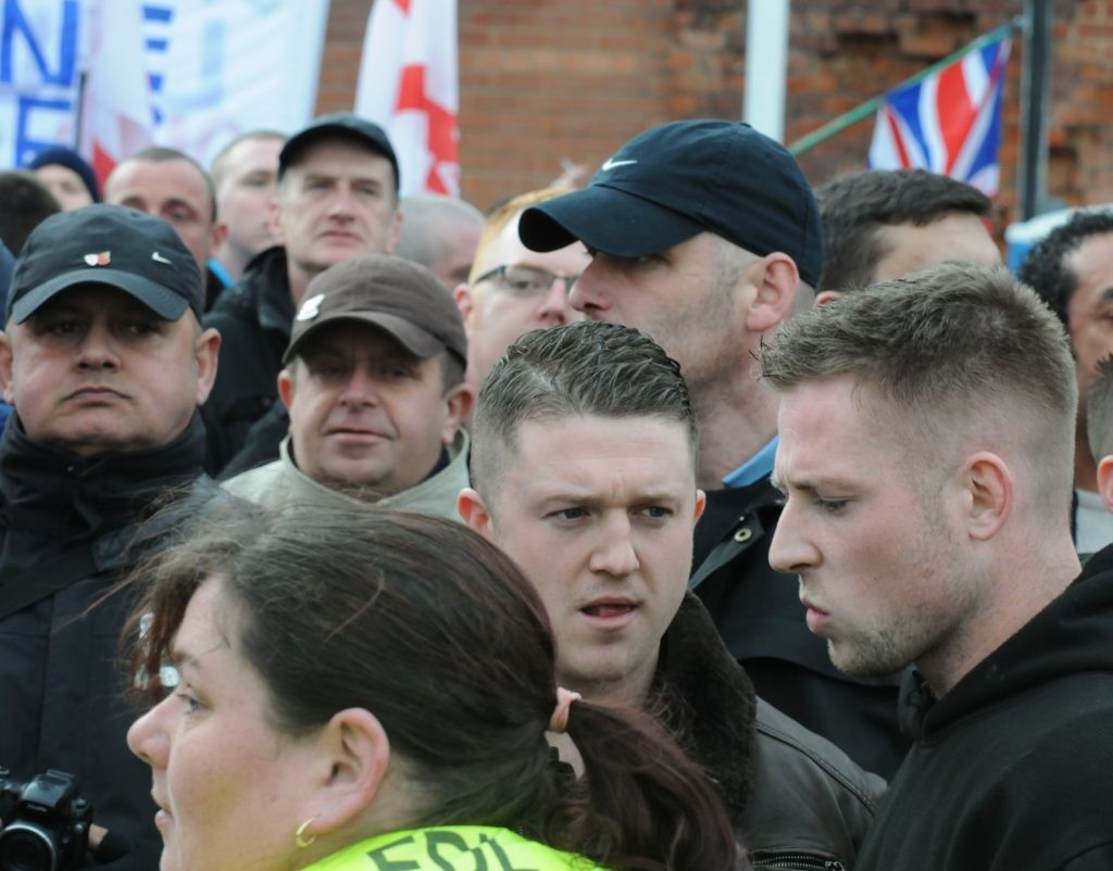 English Defence League Founder Stephen Yaxley-Lennon surrounding by EDL supporters
