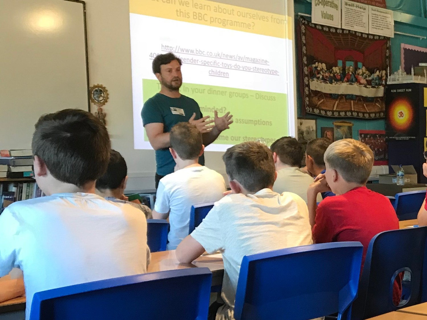 A man is teaching young people in a classroom