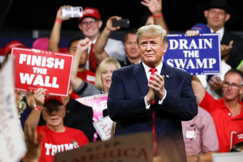 Former President Donald Trump standing behind at a Make America Great Again rally in Johnson City, Tenn., on Oct. 1, 2018.