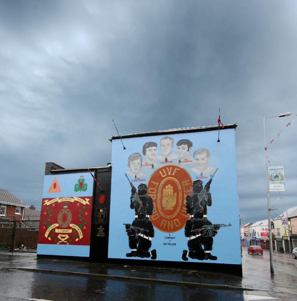 Two Belfast murals painted on the side of a building