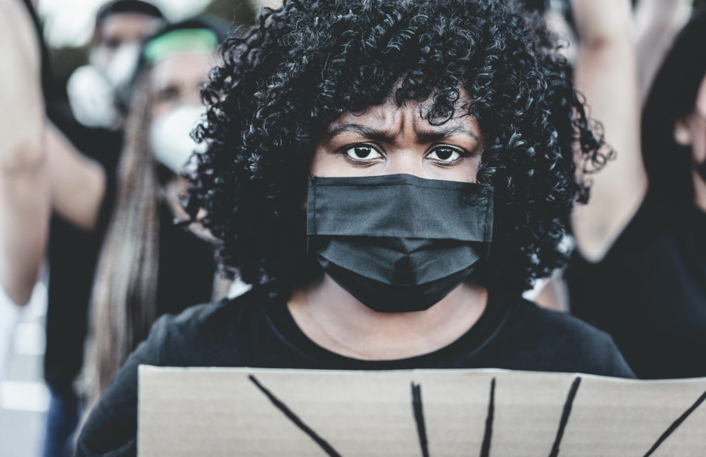 A protestor wearing a mask at the Black Lives Matter protest, 2020.