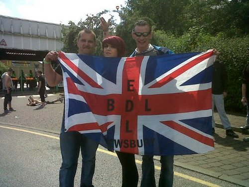 Smith (Left) with EDL flag